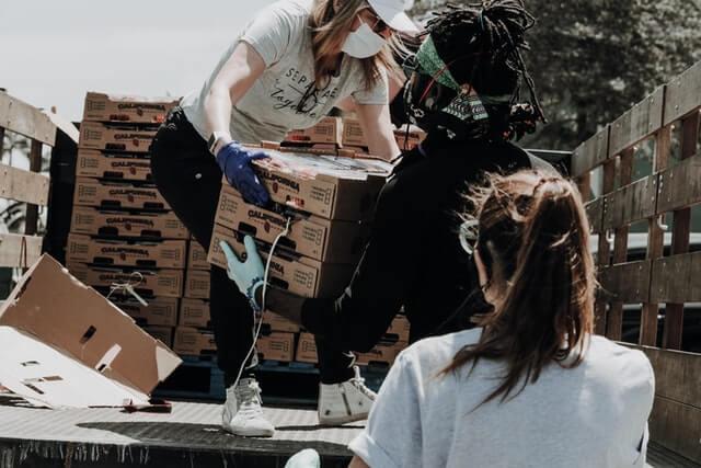 charitable 501c3 organization team donating pallets of food