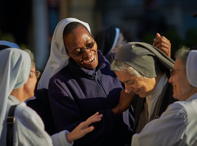 Group of laughing nuns at a Catholic nonprofit religious center