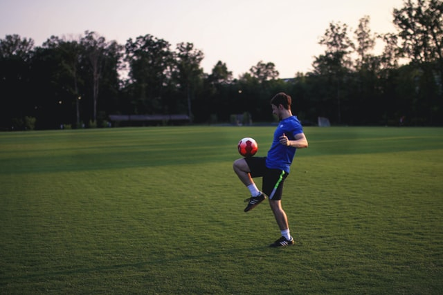 Young soccer player practicing on a field
