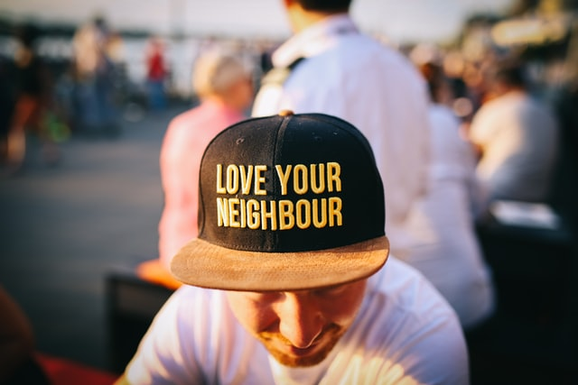 Someone wearing a love your neighbour shirt at a charity event