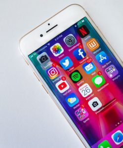 An iPhone 6 with icons for several prominent social media sites