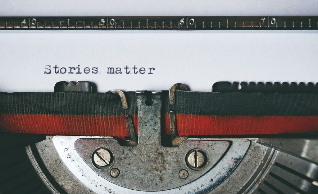 """Typewriter ribbon with the text, """"Stories matter."""""""