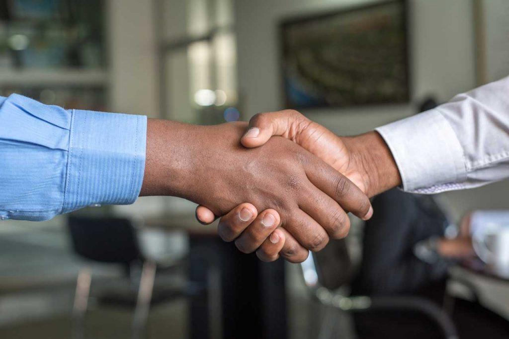 Two men shaking hands in a business arrangement
