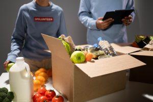 People preparing food pantry box