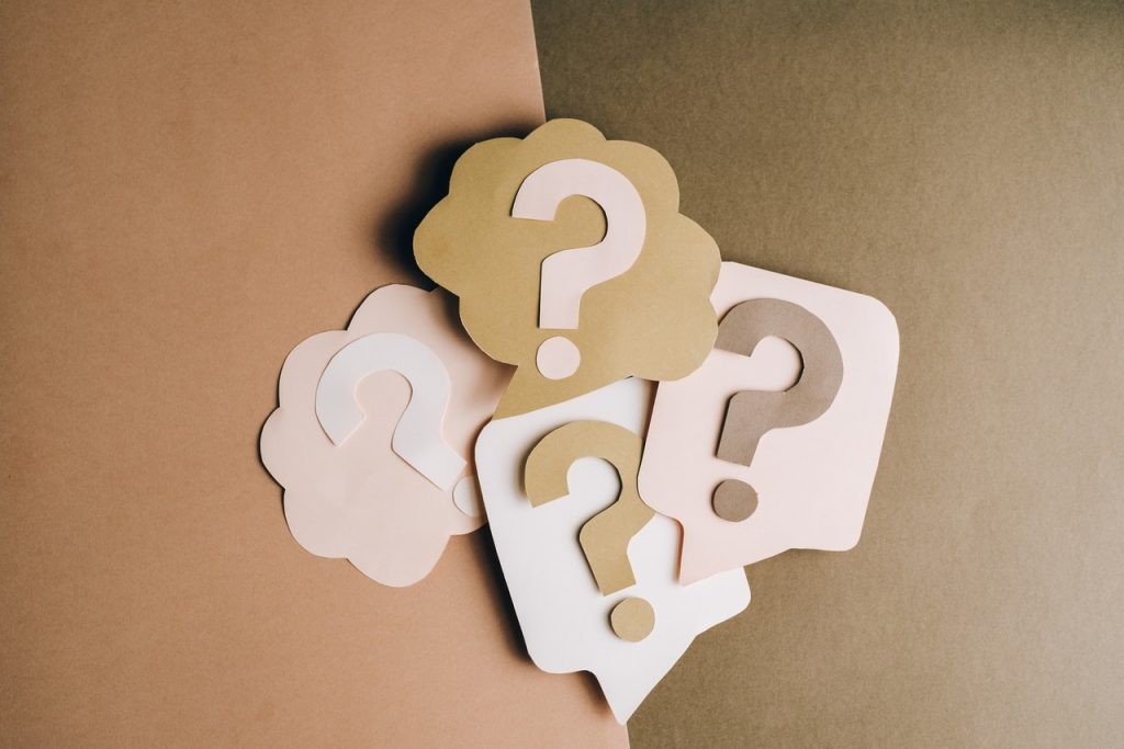 Question marks pasted on a wall