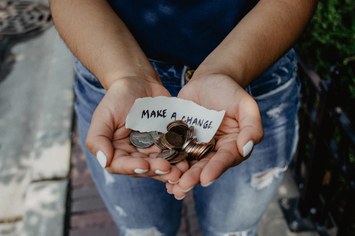 woman with a handful of change