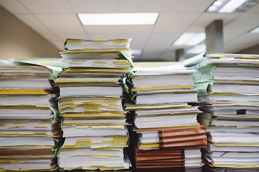 A photo of the stacks of paperwork for multi-state nonprofit registration